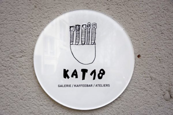 KAT18 logo at the entrance to the art gallery and coffee shop, co-conceived with artists. Photo: Marcus Weisen