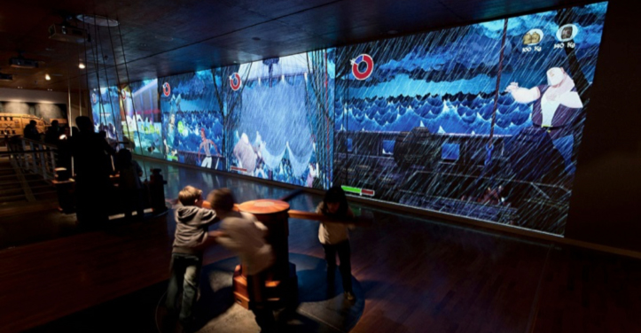 Fig. 8. Navigation Pavilion: view of new exhibition Area 3 — Sailing Simulations—showing the giant video game and full-scale interactive apparatus made with solidly crafted maritime materials.8