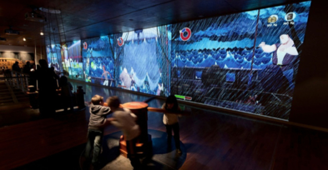 Fig. 7. Navigation Pavilion post transformation: view of new exhibition Area 3 — Sailing Simulations—showing the giant video game and full-scale interactive apparatus made with solidly crafted maritime materials.